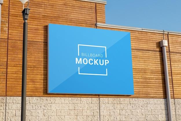 Horizontal billboard mockup on wooden wall