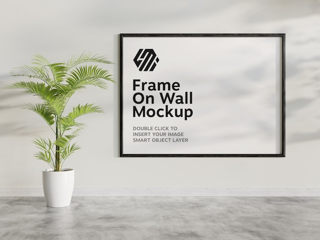 Horizontal black frame mockup hanging on wall