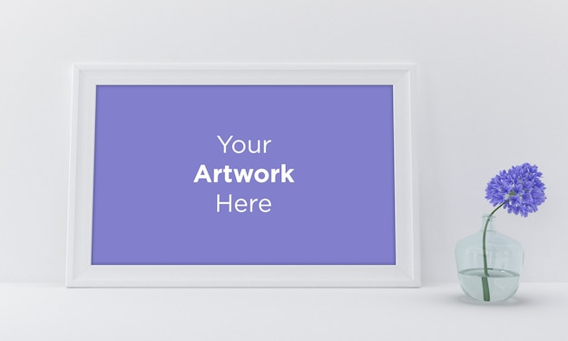 Horizontal empty photo frame mockup design on white wall