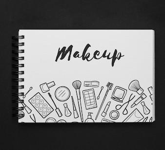 Horizontal notepad mockup with makeup drawing