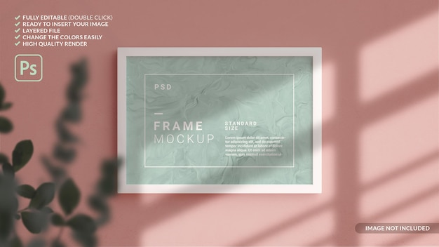 Horizontal photo frame mockup hanged in the wall in 3d rendering