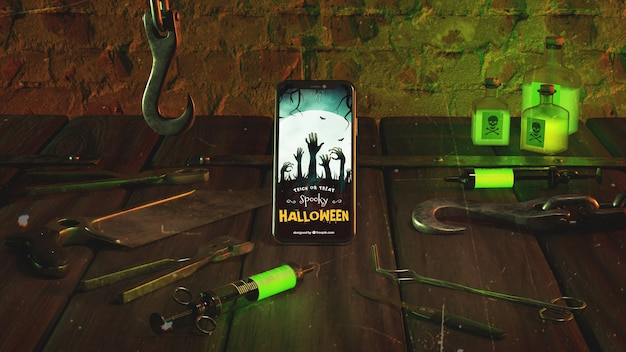 Horror halloween arrangement with smartphone