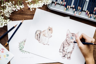 Illustrationist coloring adorable animals workspace concept