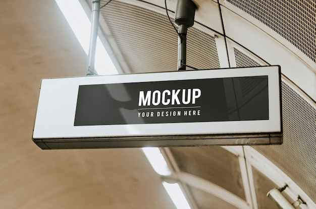 Indoor board mockup hanging from a ceiling