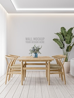 Interior dining room wall mockup on white wall with wooden table and plant