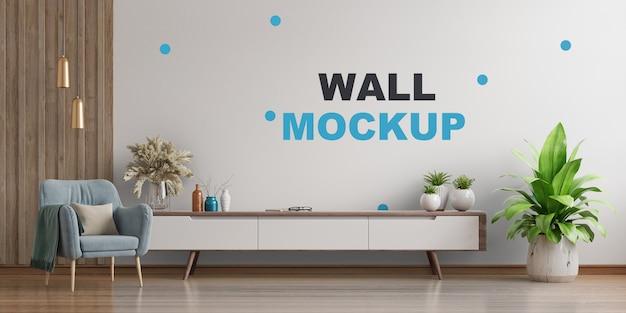 アームチェアと壁のモックアップ3dレンダリングがある明るいリビングルームのインテリア