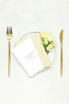 invitation card mockup on plate and gold cutlery