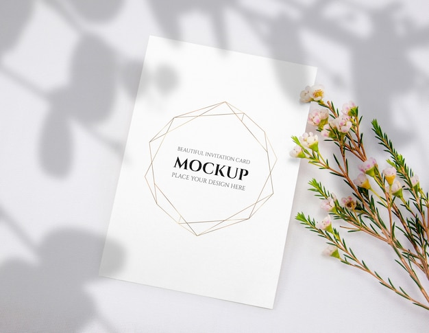 Invitation card mockup with flower.