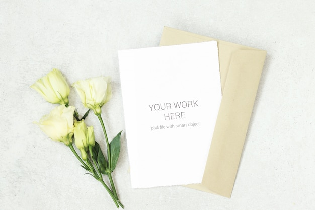 Invitation card mockup with flowers and envelope