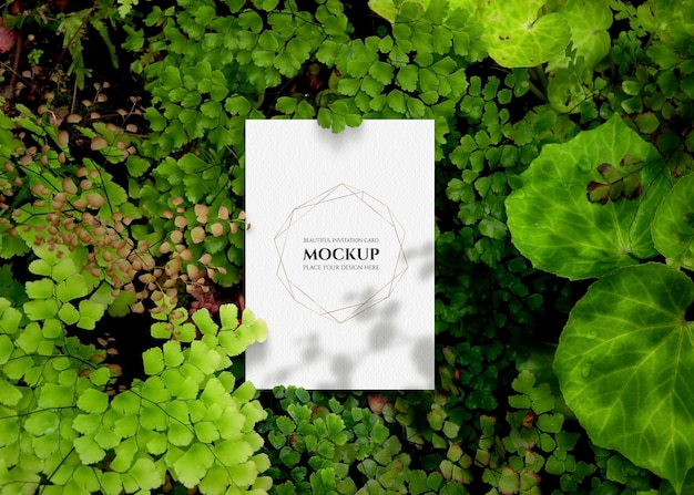 Invitation card mockup with greenery.