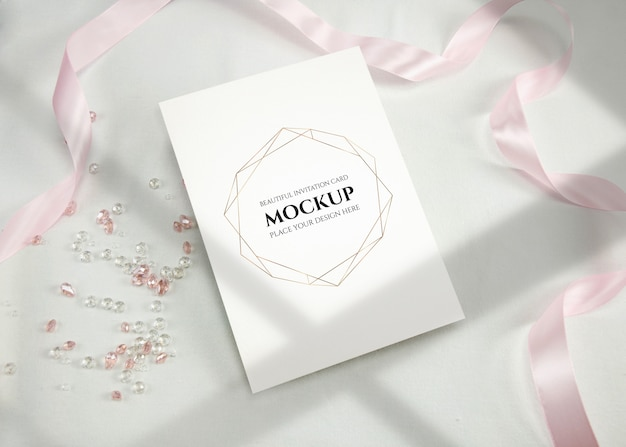 Invitation card mockup with ribbon.