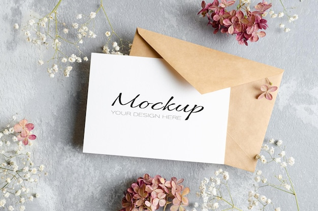 Invitation or greeting card mockup with envelope, gypsophila and hydrangea flowers