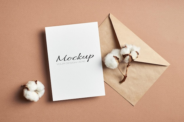 Invitation or greeting card mockup with envelope and natural cotton plant flowers
