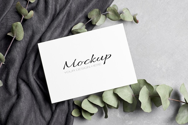 Invitation or greeting card mockup with eucalyptus twigs