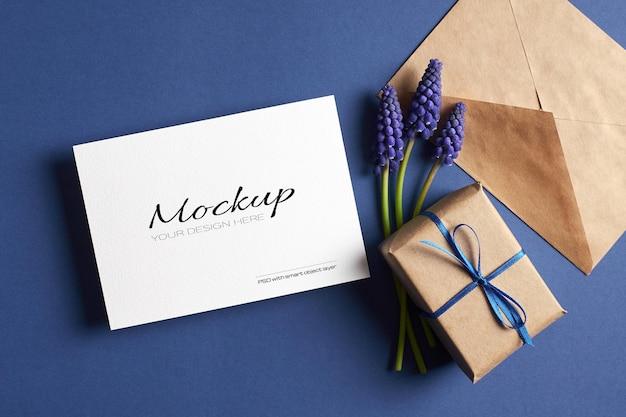 Invitation or greeting card mockup with gift box