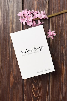 Invitation or greeting card mockup with hyacinth flower
