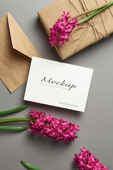 Invitation or greeting card mockup with hyacinth flowers, envelope and gift box