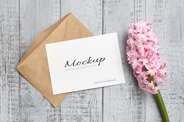 Invitation or greeting card mockup with pink hyacinth flower