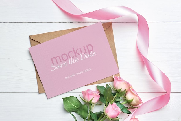 Invitation or greeting card mockup with pink roses flowers and ribbon