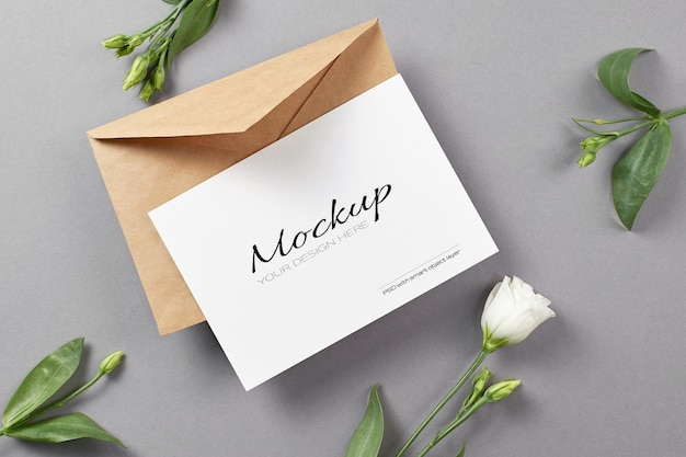 Invitation or greeting card mockup with white eustoma flowers on grey