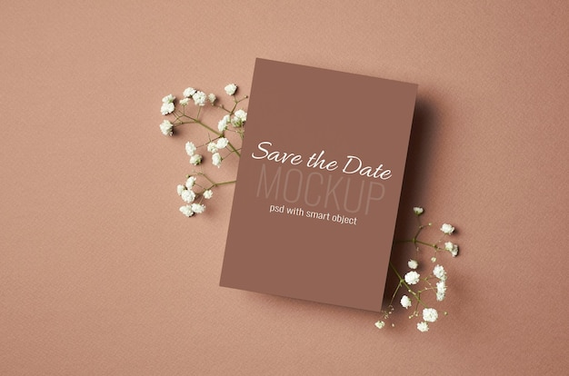 Invitation or greeting card mockup with white hypsophila