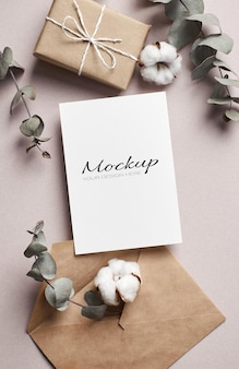Invitation or greeting card stationary mockup with gift box