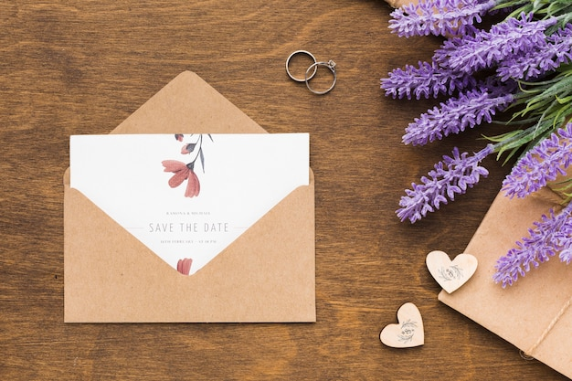 Invitation mock-up and wedding rings with lavender