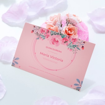 Invitation for sweet fifteen and bouquet of flowers