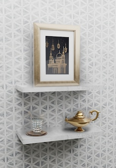 Islamic arrangement with frame and lamp on shelves