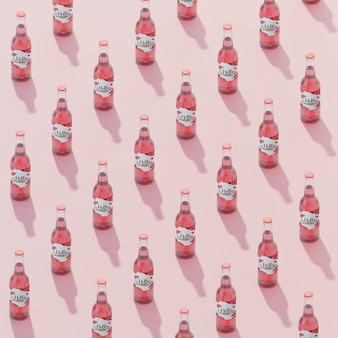 Isometric fruit soda bottles with pink background