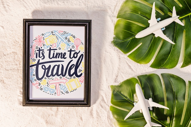 It's time to travel, lettering about traveling, with palm leaves and toy airplanes