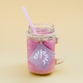 Jar mockup with pink yogurt