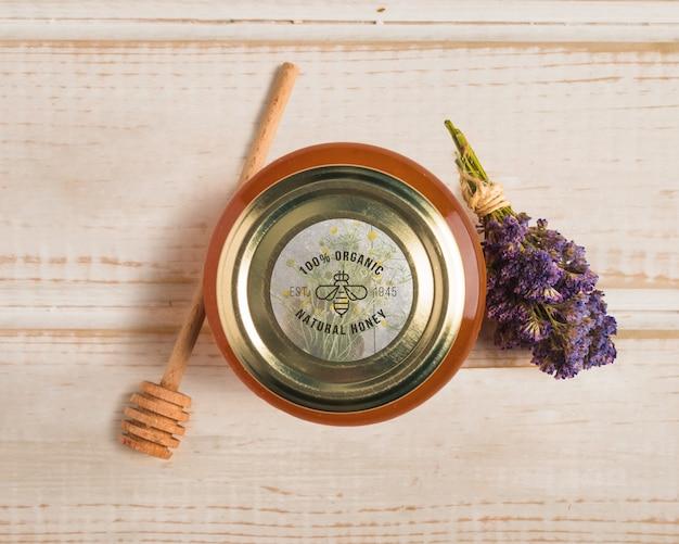 Jar with organic honey on table