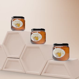 Jars with honey on honeycomb shape