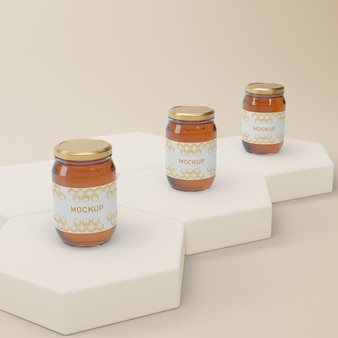 Jars with natural honey on table