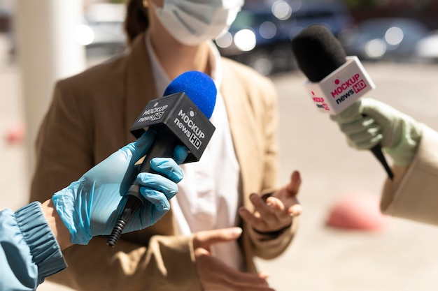 Journalist holding a microphone mockup