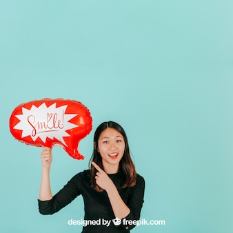 Joyful woman with speech balloon mockup