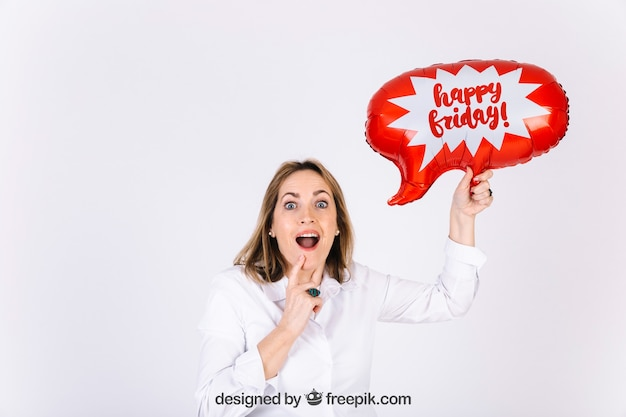 Joyful woman with speech bubble balloon for event