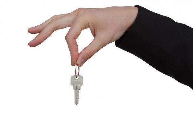 Ключ в руке на белом фоне
