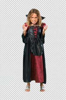 Kid dressed as a vampire at halloween holidays annoyed angry in furious gesture