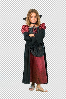 Kid dressed as a vampire at halloween holidays keeping arms crossed