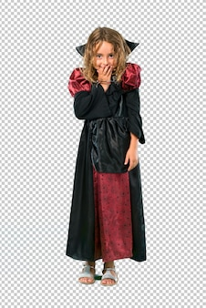 Kid dressed as a vampire at halloween holidays laughing