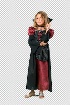 Kid dressed as a vampire at halloween holidays pointing with the index finger a great idea