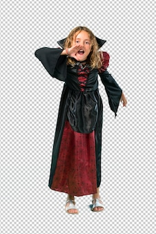 Kid dressed as a vampire at halloween holidays shouting with mouth wide open