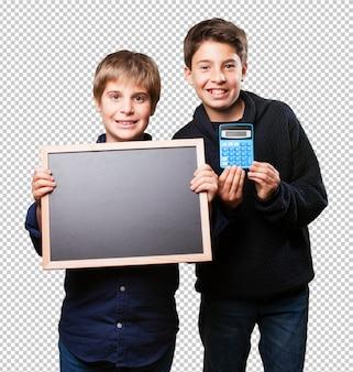 Kids holding a blackboard