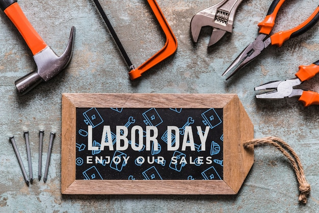Labor day mockup with wooden board and tools