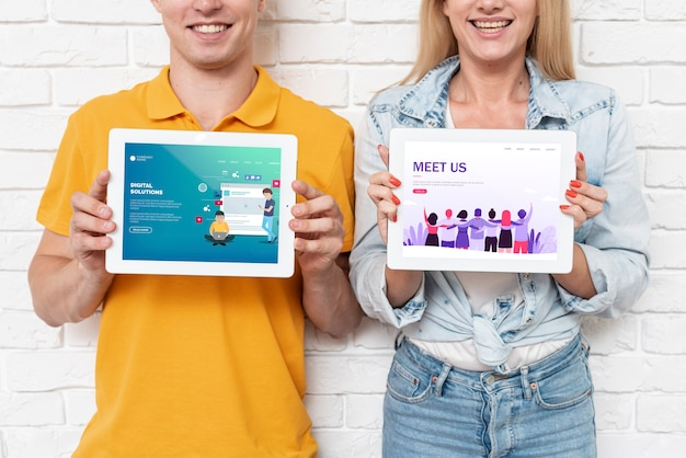Landing pages on tablets held by people