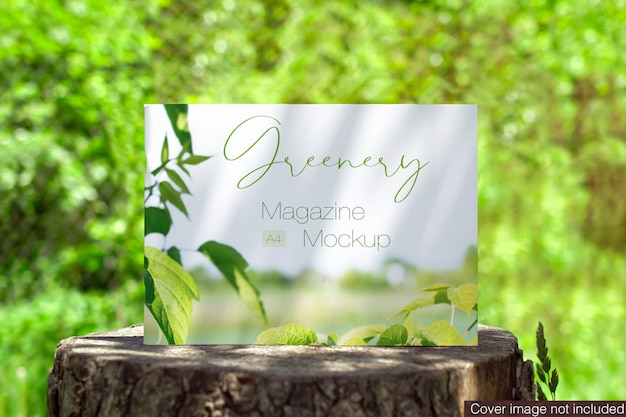 Landscape magazine on a stump stage outdoors scene mock-up
