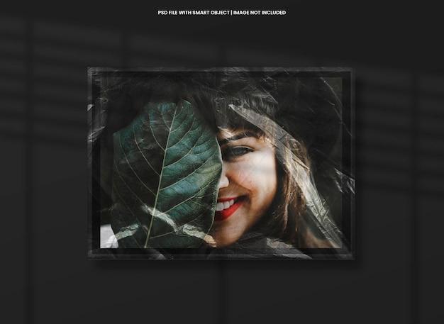 Landscape photo frame mockup with plastic effect premium psd