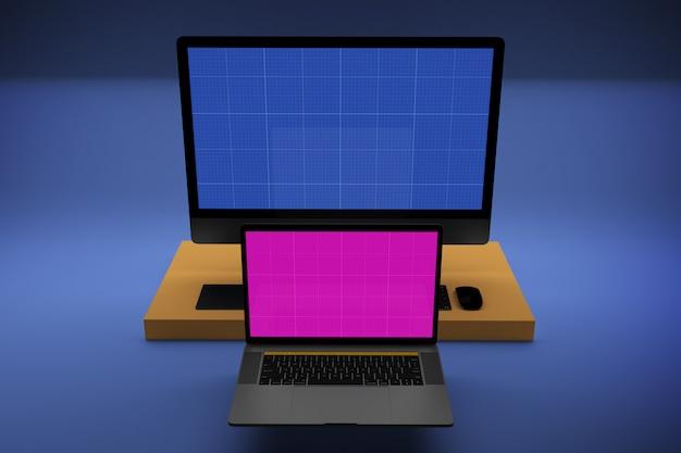 모형 화면이있는 노트북 및 데스크탑 컴퓨터